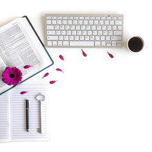 Flat Lay Open Bible / Book And Pink/purple/violette/red Gerbera Flower On A White Background. With Pink Petals, Silver Key, Keyboard, Journal, Tea, Pen, To Do 's . Baselland, Switzerland - 03.05.2019.