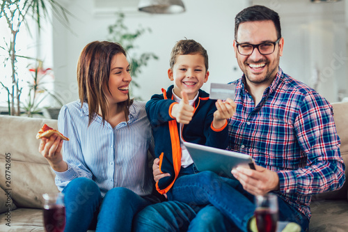 Fototapety, obrazy: Family doing online shopping with tablet