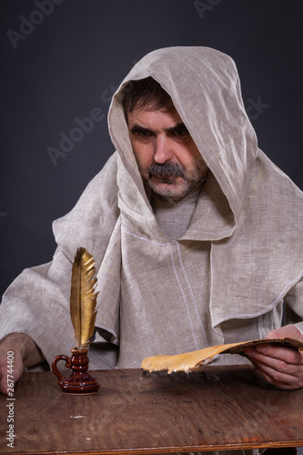 The monk alchemist was very thoughtful about writing a scientific manuscript on Canvas Print