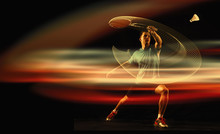Young Man Playing Badminton Over Dark Studio Background. Male Athlete In Action With Neon Light. Concept Of Motion Or Movement, Sport, Healthy Lifestyle. Attack And Defense. Creative Collage.