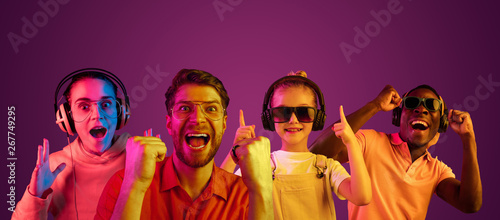 Beautiful female and male close up portrait isolated on purple neon lights studio background. Astonished people. Facial expression, summer, summertime or weekend concept. Trendy colors. Collage.