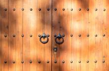 Old Wooden Door With Iron Knockers