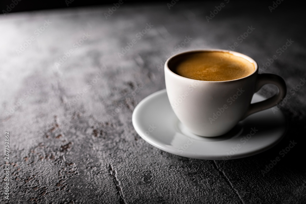 Fototapeta Coffee with foam in a cup, an aromatic hot drink.