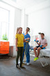 Leinwandbild Motiv Active pleasant woman working in rehabilitation center with kids