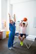 Leinwandbild Motiv Active professional nurse being involved in treating session