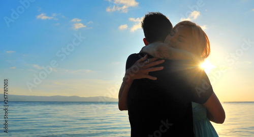 Beautiful Young Couple in Love Hug at Sunset time with Sea view Fototapeta