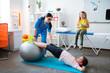 Leinwandbild Motiv Active little patient stretching whole body while leaning on pilates ball