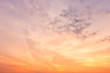 Orange sky background texture with white clouds sunset.