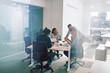 Leinwandbild Motiv Focused group of business colleagues having an office meeting to