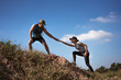 canvas print picture - Trail runner are helping women runner from a slope.