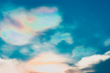 Blue sky with rainbow and white clouds. Summer background - 267804233