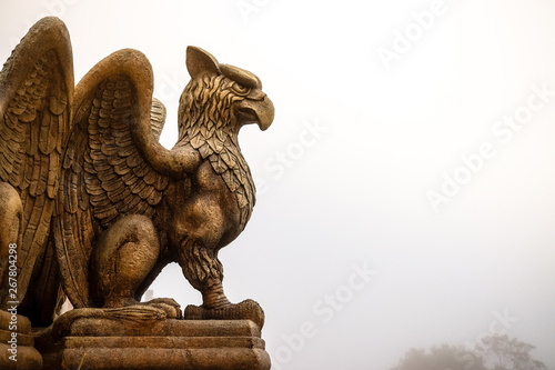 Tablou Canvas statue of Griffin or griffon a legendary creature with the body of a lion, the h