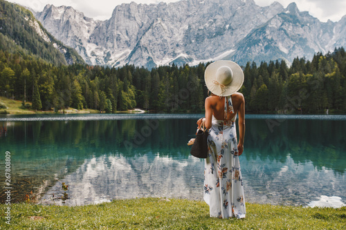 Fototapety, obrazy: Young beautiful woman in a dress and hat near the lake