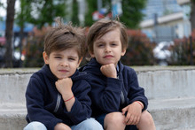 Portrait Of Fraternal Twins On Outdoor In Stylish Clothes. Children's Fashion And Style
