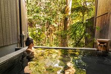 Beautiful Asian Woman Bathes N...