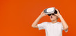 Leinwanddruck Bild - Emotional teen boy experiencing virtual reality, copy space