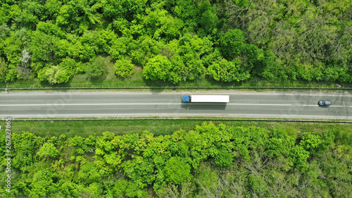 mata magnetyczna Wagon driving on the highway, aerial. Transport logistics background top view.