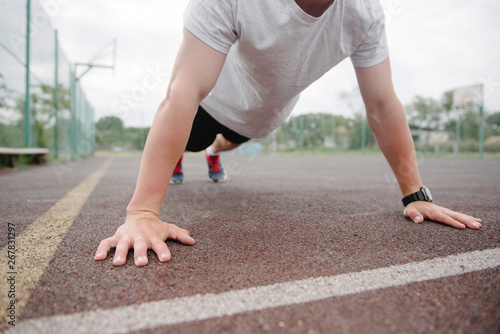 fototapeta na drzwi i meble athlete is wrung out on the sports field