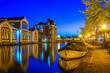 Leinwandbild Motiv Night view of canal in Leiden, Netherlands