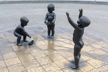 Children's Monument To The Founders Of Kiev On Poshtova Square. The Founders Of Kiev Are Depicted As Little Children Playing With Paper Ships On A Stylized Map. Kiev, Ukraine
