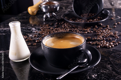 cup of coffee and beans with milk