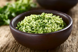 Traditional Mexican Arroz Verde green rice dish made of long-grain rice, spinach, cilantro and garlic, served in rustic bowl (Selective Focus, Focus in the middle of the image)