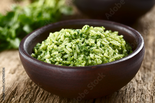 Tuinposter Londen Traditional Mexican Arroz Verde green rice dish made of long-grain rice, spinach, cilantro and garlic, served in rustic bowl (Selective Focus, Focus in the middle of the image)