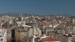 Panoramic view of Marseille, France. City architecture with Saint Vincent de Paul Church and green hills in background