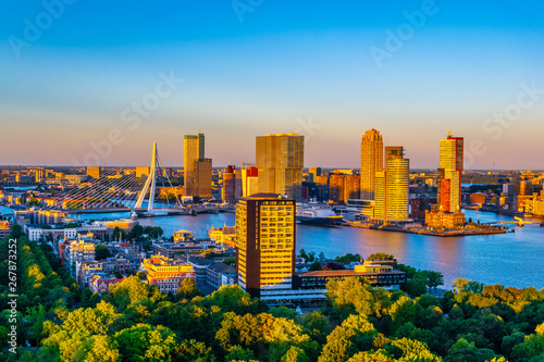 Spoed Fotobehang Rotterdam Sunset aerial view of Erasmus bridge and skyline of Rotterdam, Netherlands