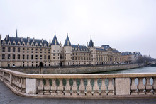View Of The Castle Conciergerie, Formerly Royal Palace And Prison, Presently It Is Part Of Complex Palais De Justice In Paris On A Cloudy Winter Day, France