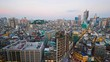 Macau, China, high angle cityscape time lapse, evening twilight nightfall.