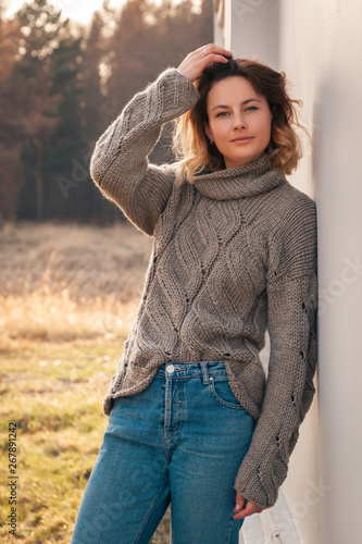 Fototapety, obrazy: Portrait of a beautiful young model in knitted hat  and warm clothes enjoy day, on background field in  sunny autumn day . Autumn warm photo.
