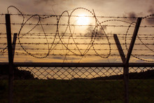 Metal Fence Wire, War And Sky ...