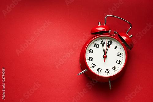 Photo Vintage Alarm Clock On Red Background.