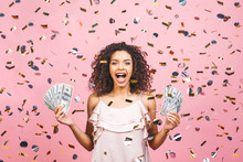 Black Afro American Girl Won Money. Happy Young Woman Holding Dollar Currency Satisfied Isolated Over Pink Background With Confetti.