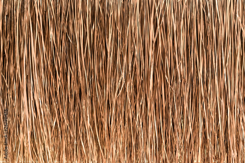 Photo Thatched roof or wall background. Tropical roofing on beach