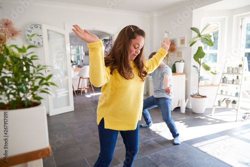Valokuva  Young Downs Syndrome Couple Having Fun Dancing At Home Together