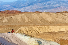 Hiker In Front Of Beautiful Landscape In Death Valley National Park. USA