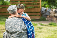 Military Man Father Hugs Son. ...