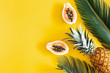 canvas print picture - Summer composition. Tropical palm leaves, hat, fruits on yellow background. Summer concept. Flat lay, top view, copy space