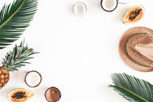 Summer Composition. Tropical Palm Leaves, Hat, Coconut, Pineapple, Papaya On White Background. Summer Concept. Flat Lay, Top View, Copy Space