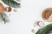 Summer Composition. Tropical Palm Leaves, Hat, Coconut, Pineapple On Pastel Gray Background. Summer Concept. Flat Lay, Top View, Copy Space