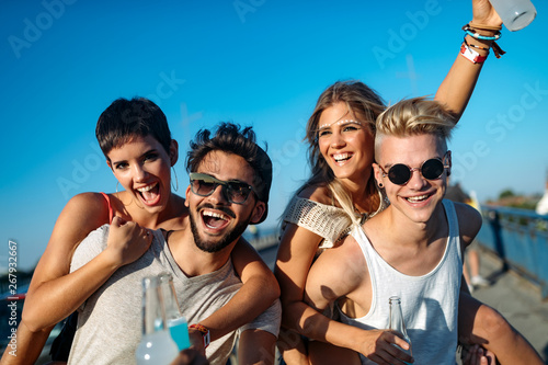 Fototapety, obrazy: Group of young friends having fun together