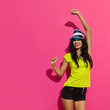 Leinwandbild Motiv Beautiful Young Woman Is Dancing Against Pink Sunny Wall