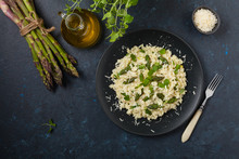 Classic Italian Risotto With Asparagus. Top View. Darkblue Background.