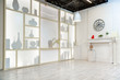 modern white studio. with a light stand in the middle, with a special light on the back wall.