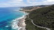 Reverse shot revealing the incredible Great Ocean Road beneath it.