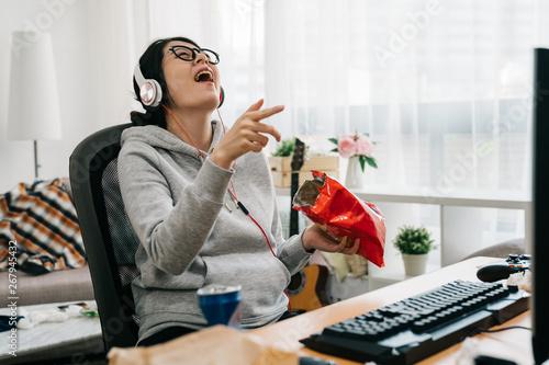 Fotografie, Obraz  asian weird computer geek stay at home on summer vacation