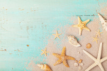 Starfishes And Seashells On Sand For Summer Holidays And Travel Background.