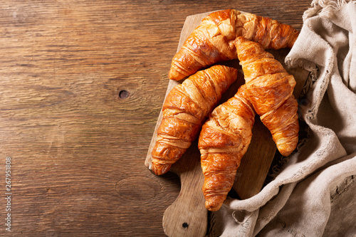 Fotobehang Bakkerij fresh croissants on wooden board